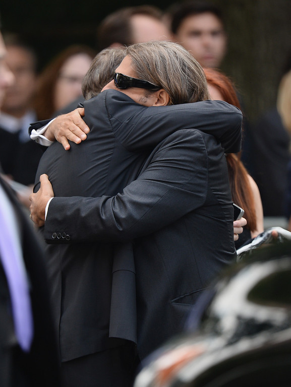 . Actors Steve Buscemi (L) and Michael Imperioli embrace at the funeral for actor James Gandolfini at The Cathedral Church of St. John the Divine on June 27, 2013 in New York City.   (Photo by Mike Coppola/Getty Images)