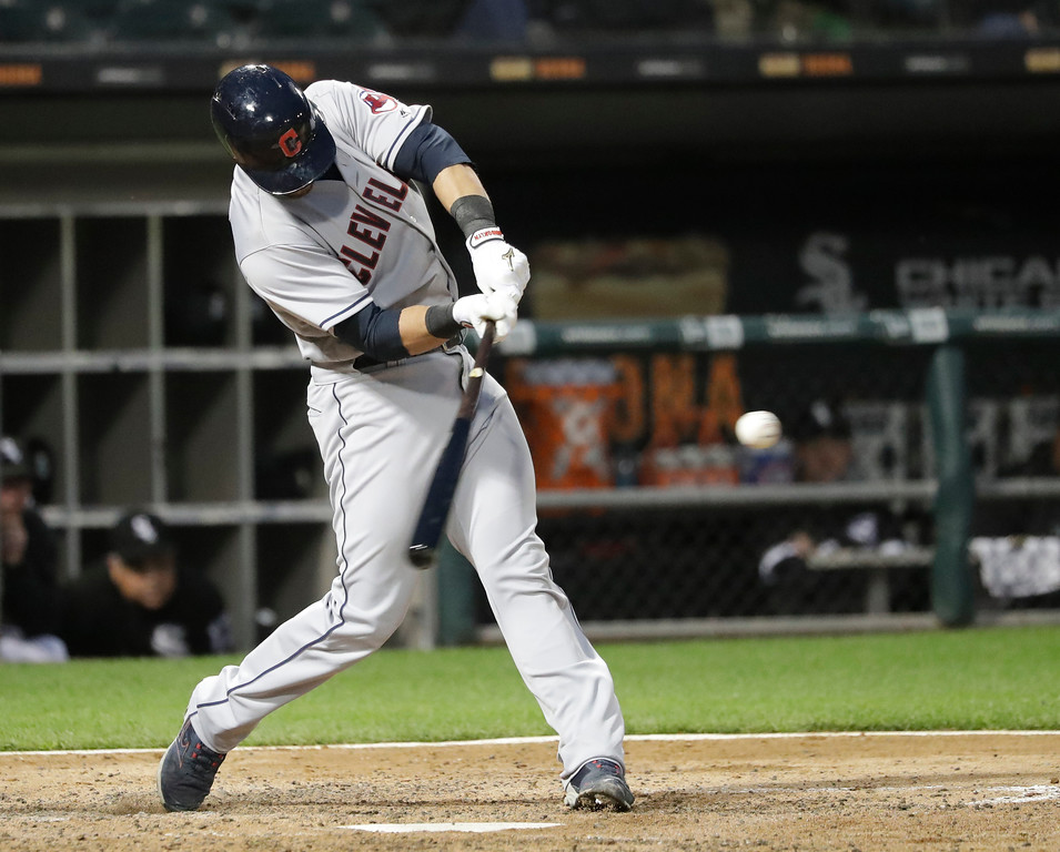 . Cleveland Indians\' Yan Gomes swings into a two-run double off Chicago White Sox starting pitcher Lucas Giolito during the fourth inning of a baseball game Monday, June 11, 2018, in Chicago. Lonnie Chisenhall and Melky Cabrera scored on the play. (AP Photo/Charles Rex Arbogast)