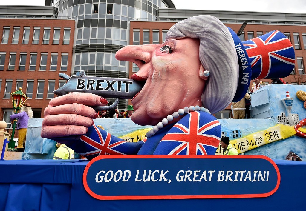 . A carnival float depicts British Prime Minister Theresa May with a gun and the writing \'Brexit\' on it prior to the traditional carnival parade in Duesseldorf, Germany, on Monday, Feb. 27, 2017. The foolish street spectacles in the carnival centers of Duesseldorf, Mainz and Cologne, watched by hundreds of thousands of people, are the highlights in Germany\'s carnival season on Rosemonday. (AP Photo/Martin Meissner)