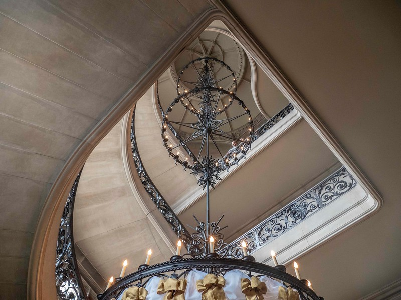 Staircase and huge mulitilevel chandelier