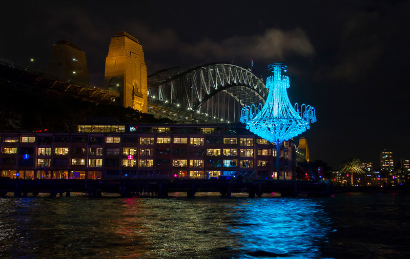 Sydney Harbor Bridge at night.  The chandelier was part of the Vivid Sydney show and appears as if it is magically suspended in midair.