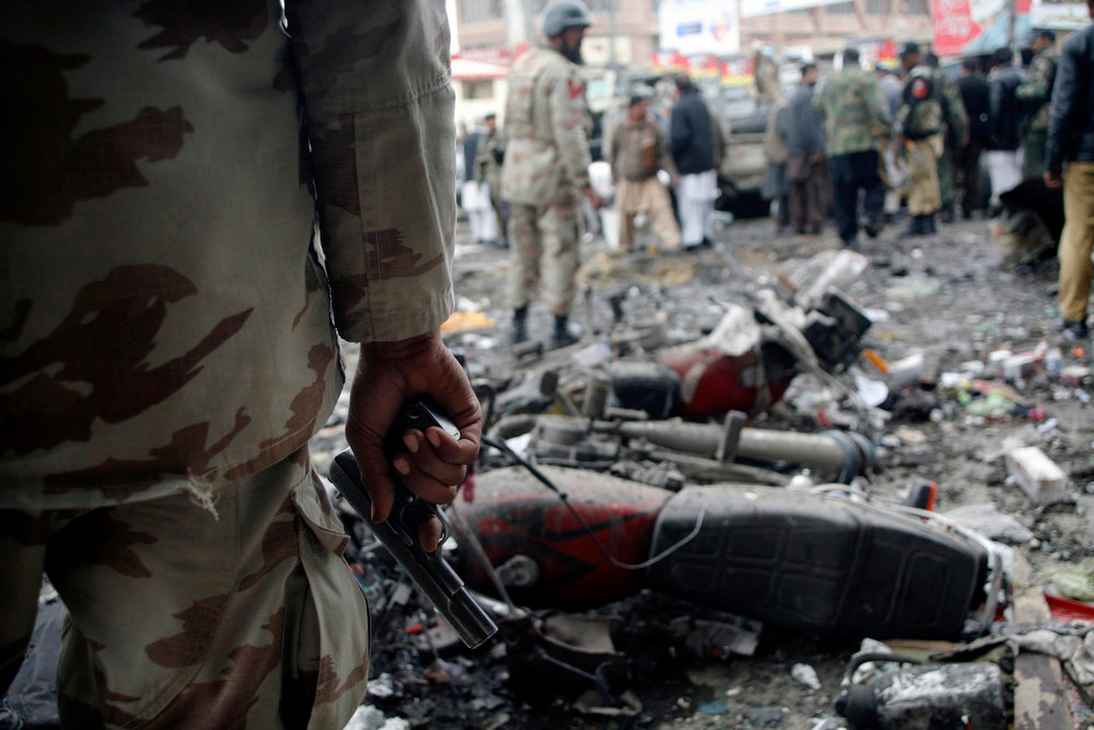 Description of . A paramilitary soldier stands guard at the scene of a bomb explosion in Quetta January 10, 2013. A bomb blast in a crowded marketplace killed 11 people and injured more than 40 in Pakistan's eastern provincial capital of Quetta on Thursday and a local militant group claimed responsibility, police said. REUTERS/Naseer Ahmed
