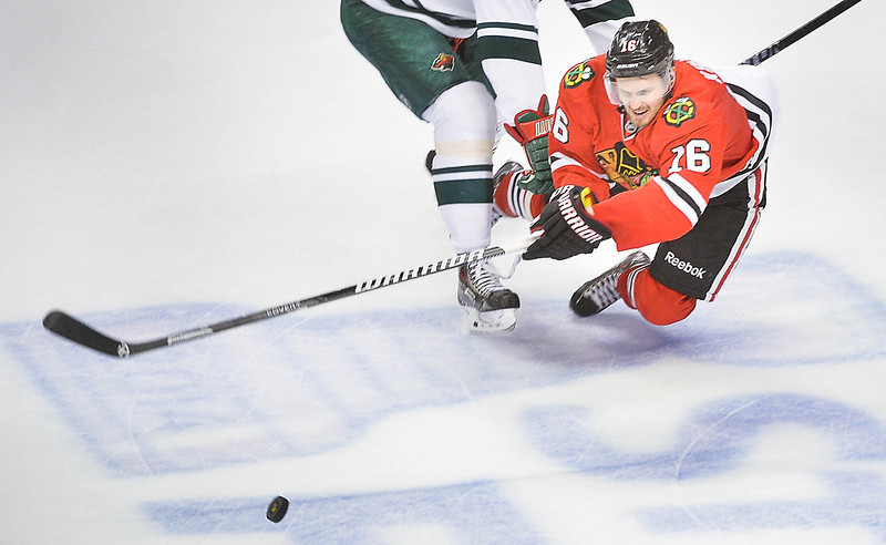 . Chicago Blackhawks center Marcus Kruger dives to clear the puck with seconds left during the third period. (Pioneer Press: Ben Garvin)