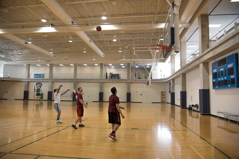 Issac Neyra (left), Ricardo Salinas, & John Friesen-Lee play basketball in the Dugan Wellness Center.