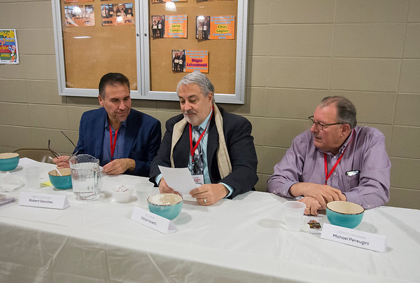 01/30/20 Wesley Bunnell | StaffrrThe annual SOUPerBowl to benefit the Friendship Centers Soup Kitchen took place on Thursday Jan 30, 2020 at E.C. Goodwin Technical School. Judges State Rep. Robert Sanchez, CMHA's Victor Incerti and Costco's Michael Pereugini talk over the selections.