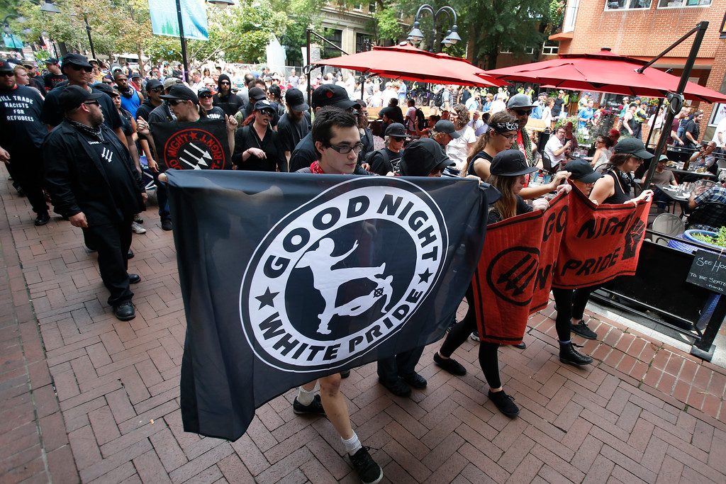 . A group anti-fascism demonstrators march in the downtown area in anticipation of the anniversary of last year\'s Unite the Right rally in Charlottesville, Va., Saturday, Aug. 11, 2018. (AP Photo/Steve Helber)