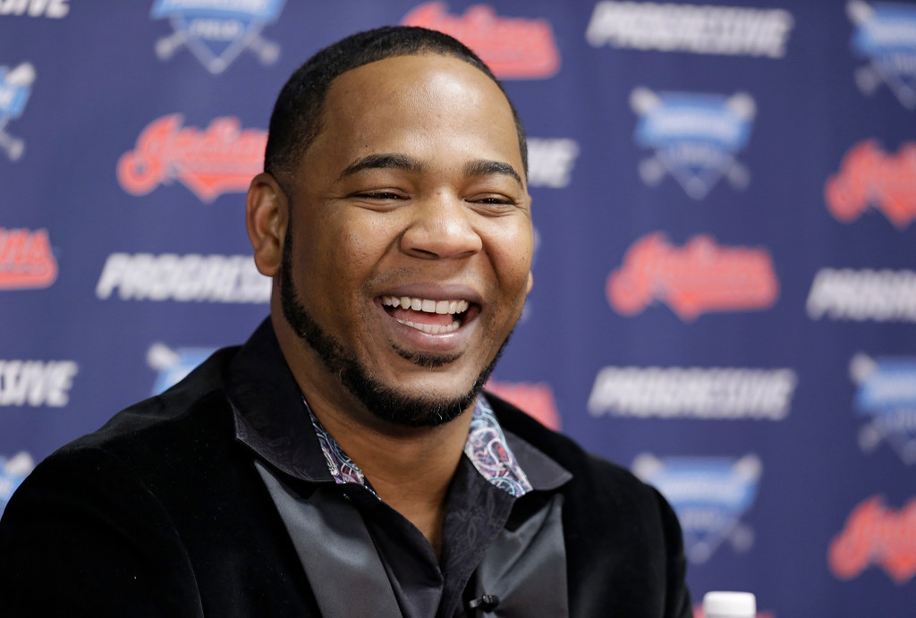 . Cleveland Indians\' Edwin Encarnacion smiles during a news conference, Thursday, Jan. 5, 2017, in Cleveland. One win from a World Series baseball title last season, the Indians finalized a $65 million, three-year contract with free agent slugger Encarnacion on Thursday. (AP Photo/Tony Dejak)