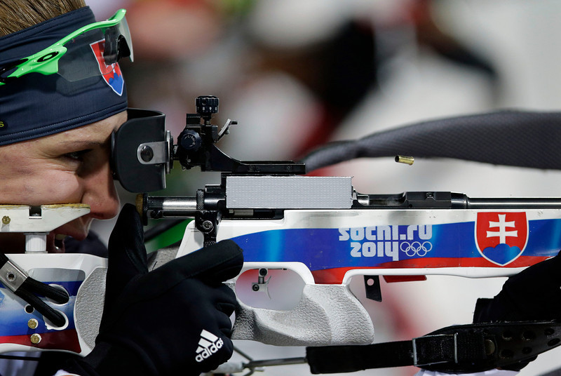. Slovakia\'s Anastasiya Kuzmina shoots during the women\'s biathlon 10k pursuit, at the 2014 Winter Olympics, Tuesday, Feb. 11, 2014, in Krasnaya Polyana, Russia. (AP Photo/Lee Jin-man)