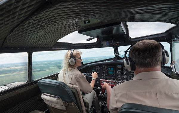 DAVID LIPNOWSKI / WINNIPEG FREE PRESS  Ken and Lorraine Morris pilot a Boeing B-17 Bomber (Flying Fortress) during a media flight from the Gimli Airport Wednesday July 6, 2016. The World War 2 era plane is one of only 13 aircraft of its type still flying.