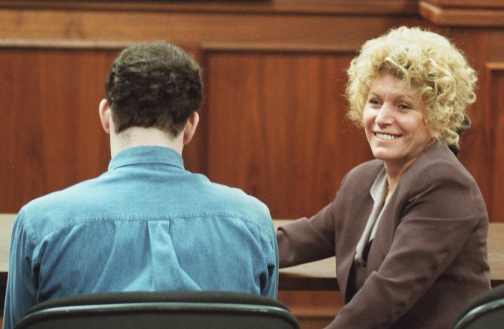 . Erik Menendez, left, sits while his attorney, Leslie Abramson smiles after the jury recommended life in prison without the possibilty of parole Wednesday, April 17, 1996 at a court in the Van Nuys section of Los Angeles. Erik and his brother Lyle were found guilty of the 1989 killing of their parents. (AP Photo/Phil McCarten, Pool)