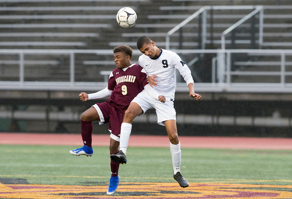 10/29/19 Wesley Bunnell | StaffrrNew Britain soccer was defeated 2-0 by Newington during a drizzle at Veterans Stadium on Tuesday afternoon. New Britain's Shevon Traille (9) and Newington's Adam Khadrani (9).