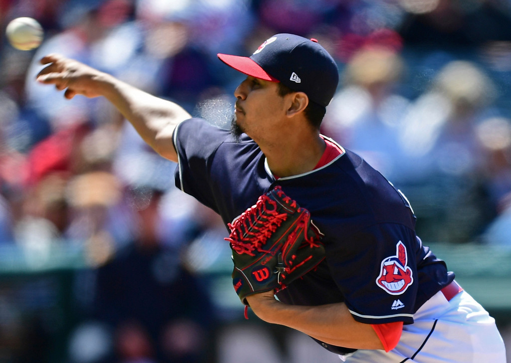 . Cleveland Indians starting pitcher Carlos Carrasco delivers in the seventh inning of a baseball game against the Milwaukee Brewers, Wednesday, June 6, 2018, in Cleveland. The Indians won 3-1. (AP Photo/David Dermer)