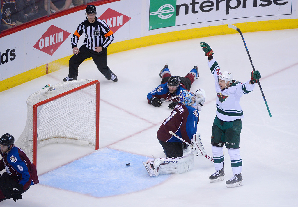 . Nino Niederreiter (22) of the Minnesota Wild reacts after he scored the game-winning goal in overtime past Semyon Varlamov (1) of the Colorado Avalanche. The Colorado Avalanche fell 5-4 to the Minnesota Wild in game 7 of their Stanley Cup Playoff series at the Pepsi Center in Denver, Colorado on Wednesday, April 30, 2014. (Photo by Karl Gehring/The Denver Post)