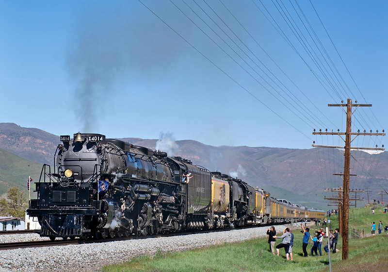 May 12, 2019.  The train passes onlookers just south of Henefer, Utah.  Lots of waving going on!  One of the things I found interesting about this stretch of the UP is the old code lines still were in place and looked to be in good condition for the most part.  Have no idea if they are still used by the railroad, I did see a few leaning precariously.  I was able to get this shot only because the train made a fairly long stop at Morgan, and the traffic jam that I was trapped in had a chance to get ahead of the train.
