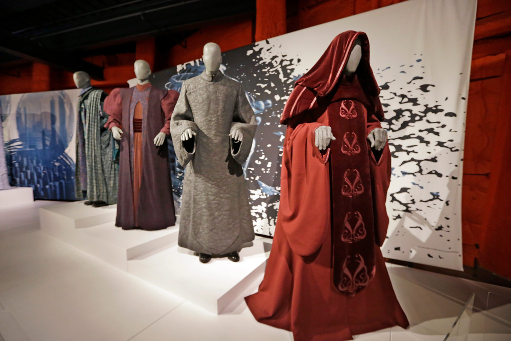 . In this photo taken Thursday, Jan. 29, 2015, Senate and Trade Federation robes are displayed as part of an exhibit on the costumes of Star Wars at Seattle�s EMP Museum. The creators of the new exhibit, with 60 original costumes from the six Star Wars movies, are hoping to gather geeks, fashionistas and movie fans together to discuss how clothing helps set the scene. The exhibit, �Rebel, Jedi, Princess, Queen: Star Wars and the Power of Costume,� will be in Seattle through early October and then travel across the United States through 2020. (AP Photo/Elaine Thompson)