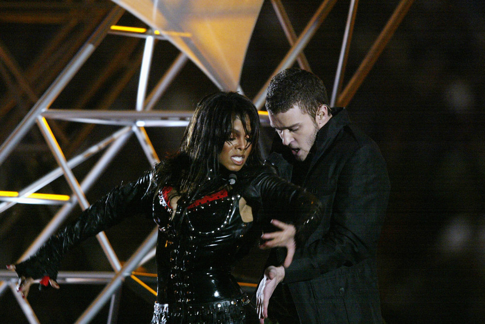 Description of . Singers Janet Jackson and Justin Timberlake perform during the halftime show at Super Bowl XXXVIII between the New England Patriots and the Carolina Panthers at Reliant Stadium on February 1, 2004 in Houston, Texas. (Photo by Donald Miralle/Getty Images) The Patriots won 32-29 to claim their second Super Bowl in three years. (Photo by Donald Miralle/Getty Images)