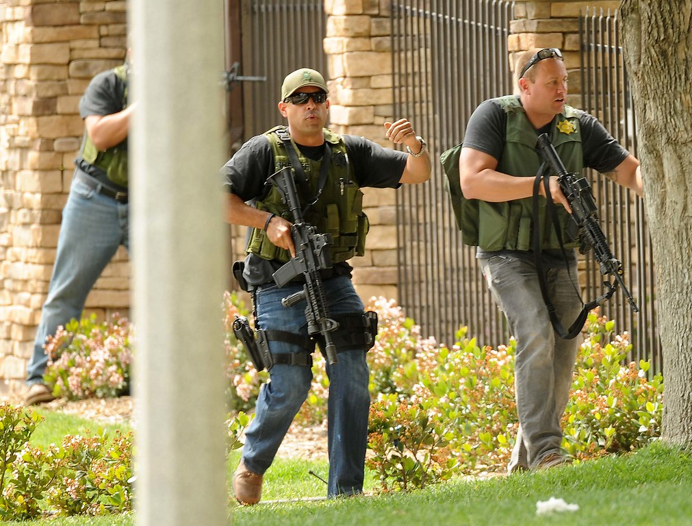 . Deputies search for a man suspected of shooting another man in the 25400 block of West Pacific St. near Del Rosa Avenue on Thursday. (LaFonzo Carter/ Staff Photographer)