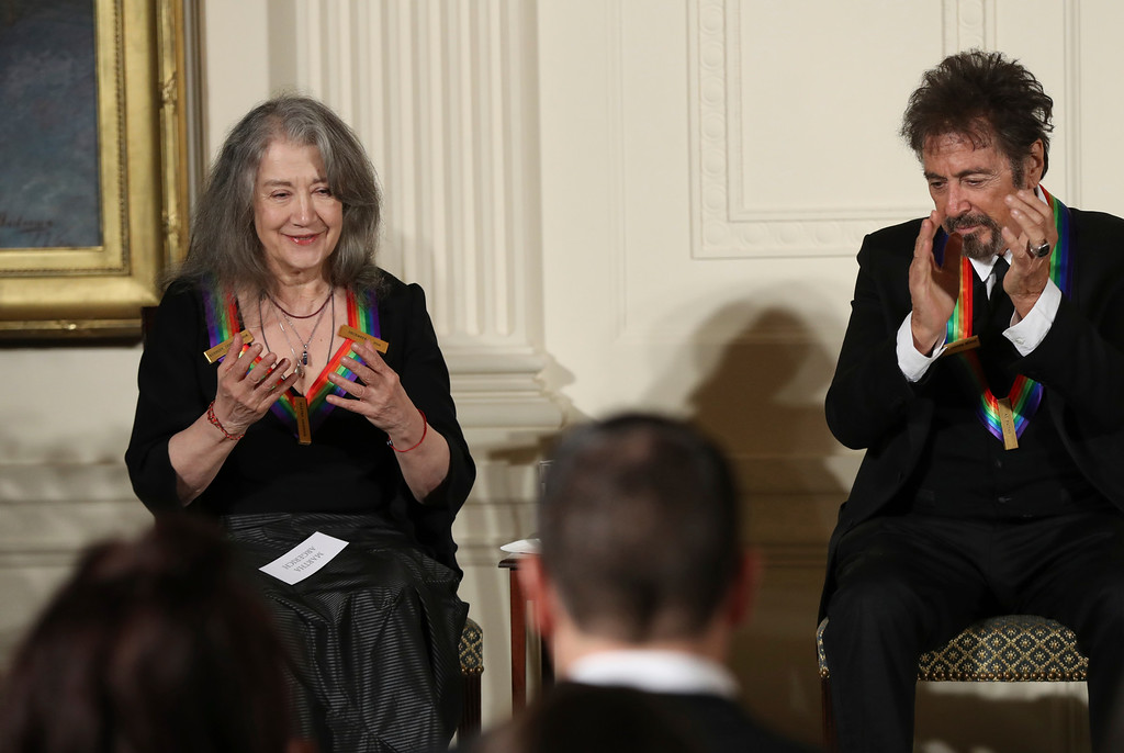 . The recipients of the 2016 Kennedy Center Honors, Argentine pianist Martha Argerich, left, with actor Al Pacino, makes a gesture as she is recognized during a reception in their honor in the East Room of the White House in Washington, Sunday, Dec. 4, 2016, hosted by President Barack Obama and first lady Michelle Obama. (AP Photo/Manuel Balce Ceneta)