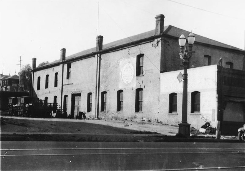 Exterior view of the silk and woolen mill owned by the Reverend B. F. Coulter on the west side of Figueroa Street north of Sixth Street, ca.1931