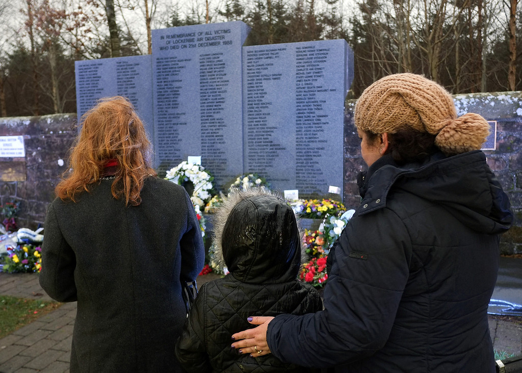 . Families and relatives attend a memorial service in Dryfesdale cemetery to commemorate the 25th anniversary of the air disaster on December 21, 2013 in Lockerbie, Scotland.  (Photo by Ian Forsyth/Getty Images)