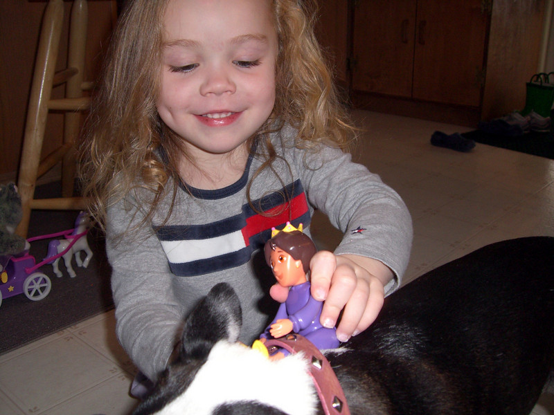 Kimber playing with Chloe by making her be the 'horse.'