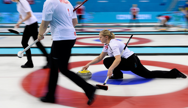 . Denmark\'s Helle Simonsen throws the stone during the women\'s curling round robin session 2 match between Switzerland and Denmark at the Ice Cube curling centre in Sochi on February 11, 2014 during the 2014 Sochi winter Olympics. (JONATHAN NACKSTRAND/AFP/Getty Images)