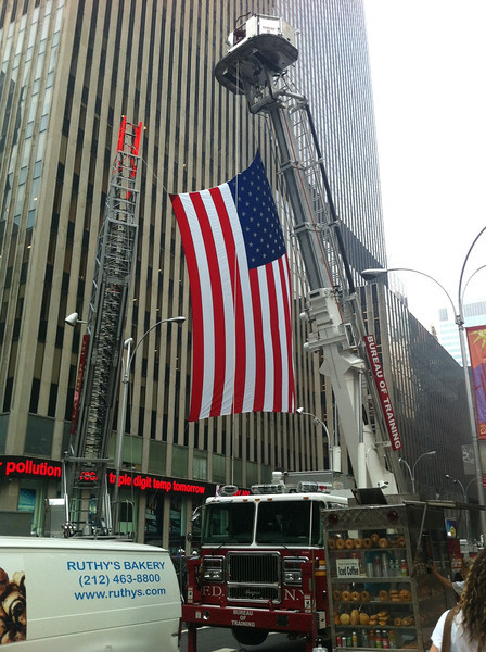 Wounded Warrior Project Sponsoring an event with the NYFD in NYC 7-21-11.  Fire trucks hung a huge american flag over 48th street.