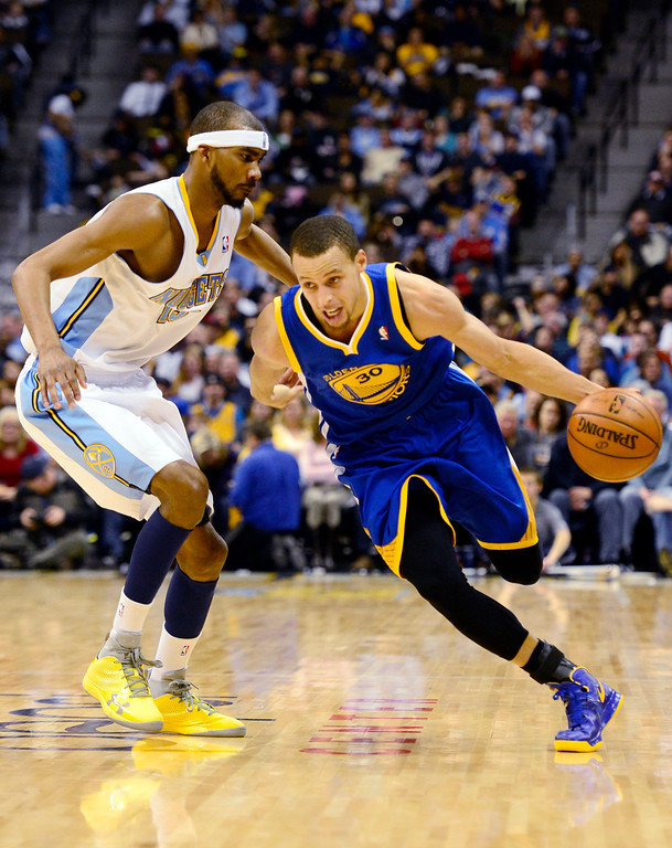 . Golden State Warriors point guard Stephen Curry (30) drives past Denver Nuggets small forward Corey Brewer (13) during the second half of the Nuggets\' 116-105 win at the Pepsi Center on Sunday, January 13, 2013. AAron Ontiveroz, The Denver Post