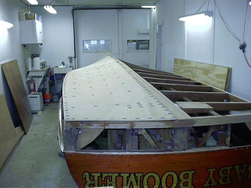 Starboard rear view of first layer of bottom glued in place.