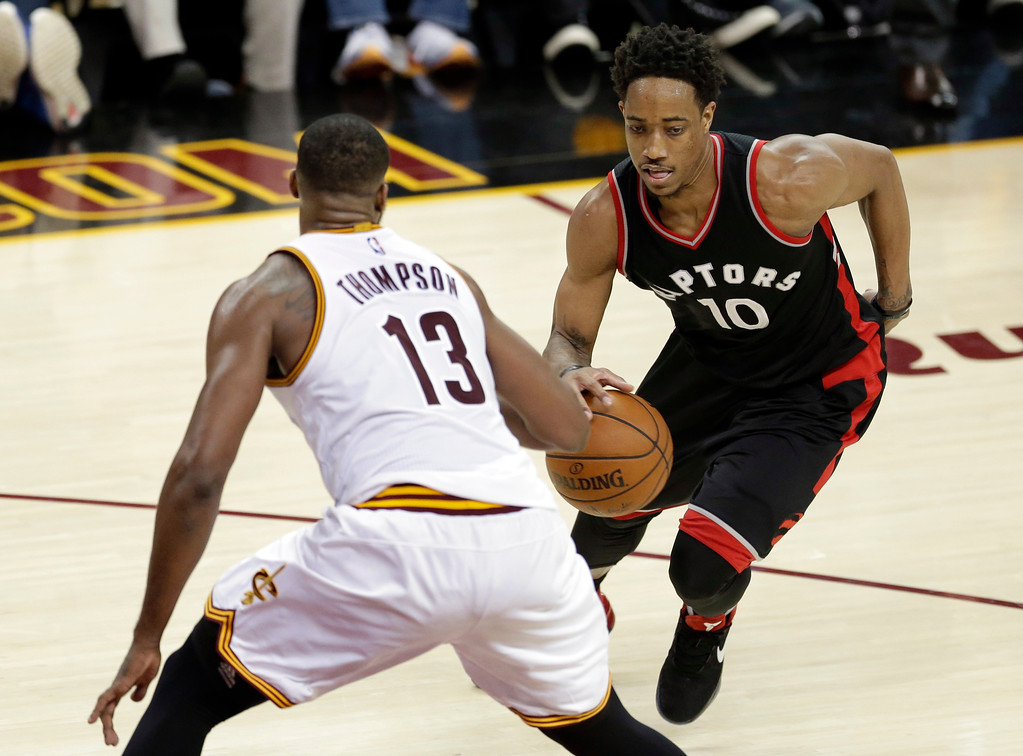 . Toronto Raptors\' DeMar DeRozan (10) drives past Cleveland Cavaliers\' Tristan Thompson (13) in the second half in Game 1 of a second-round NBA basketball playoff series, Monday, May 1, 2017, in Cleveland. The Cavaliers won 116-105. (AP Photo/Tony Dejak)