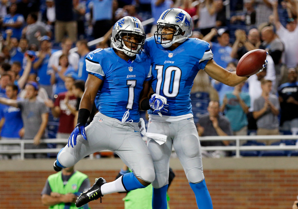 . Detroit Lions wide receiver Corey Fuller (10) celebrates his 21-yard touchdown reception against the Cleveland Browns with Andrew Peacock (1) in the second half of a preseason NFL football game at Ford Field in Detroit, Saturday, Aug. 9, 2014. Detroit won 13-12. (AP Photo/Rick Osentoski)