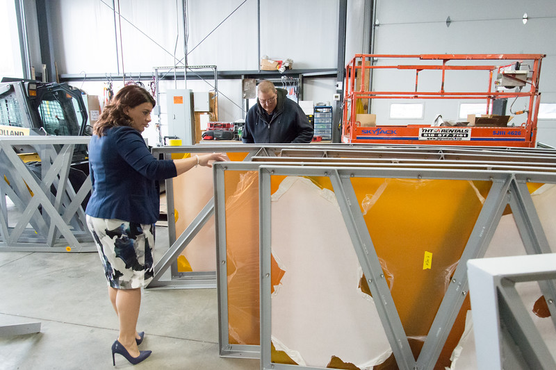 02/15/19  Wesley Bunnell | Staff  Mayor Erin Stewart walks through trim pieces featuring colored plexiglass at Sign Pro on Friday during a status tour visit with city employees.