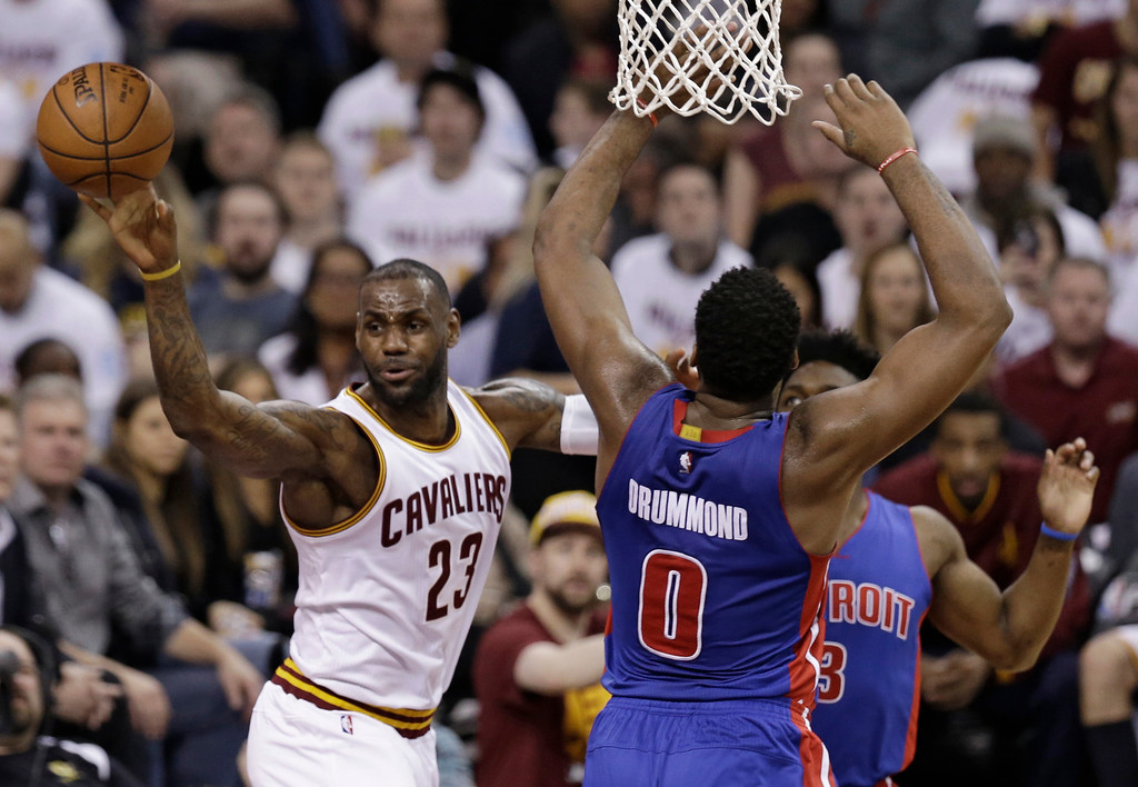 . Cleveland Cavaliers\' LeBron James (23) passes around Detroit Pistons\' Andre Drummond (0) in the first half in Game 2 of a first-round NBA basketball playoff series, Wednesday, April 20, 2016, in Cleveland. (AP Photo/Tony Dejak)