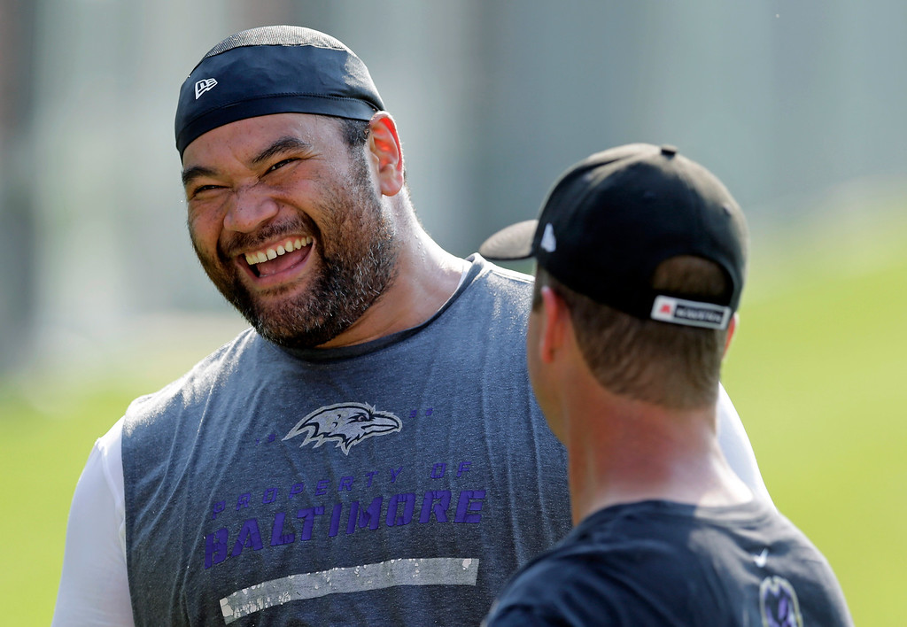 . Baltimore Ravens nose tackle Haloti Ngata, left, laughs as he chats with head coach John Harbaugh after an NFL football practice, Tuesday, June 17, 2014, at the team\'s practice facility in Owings Mills, Md. (AP Photo/Patrick Semansky)