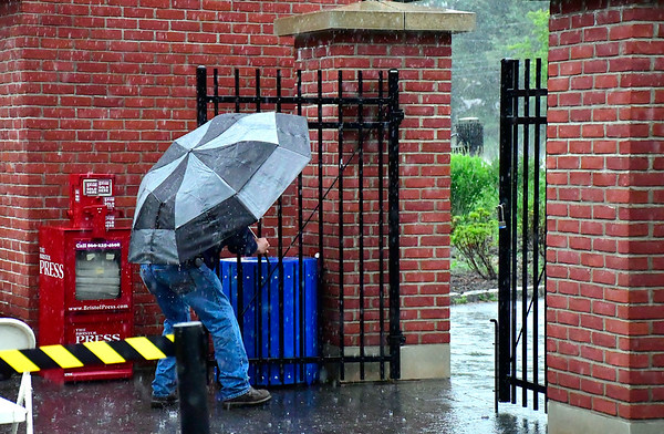 5/29/2019 Mike Orazzi | Staff Bristol Park & Recreation's Dean Dionne locks the gate at Muzzy Field as the season opening game for the Bristol Blues got canceled because of rain in Bristol Wednesday night.