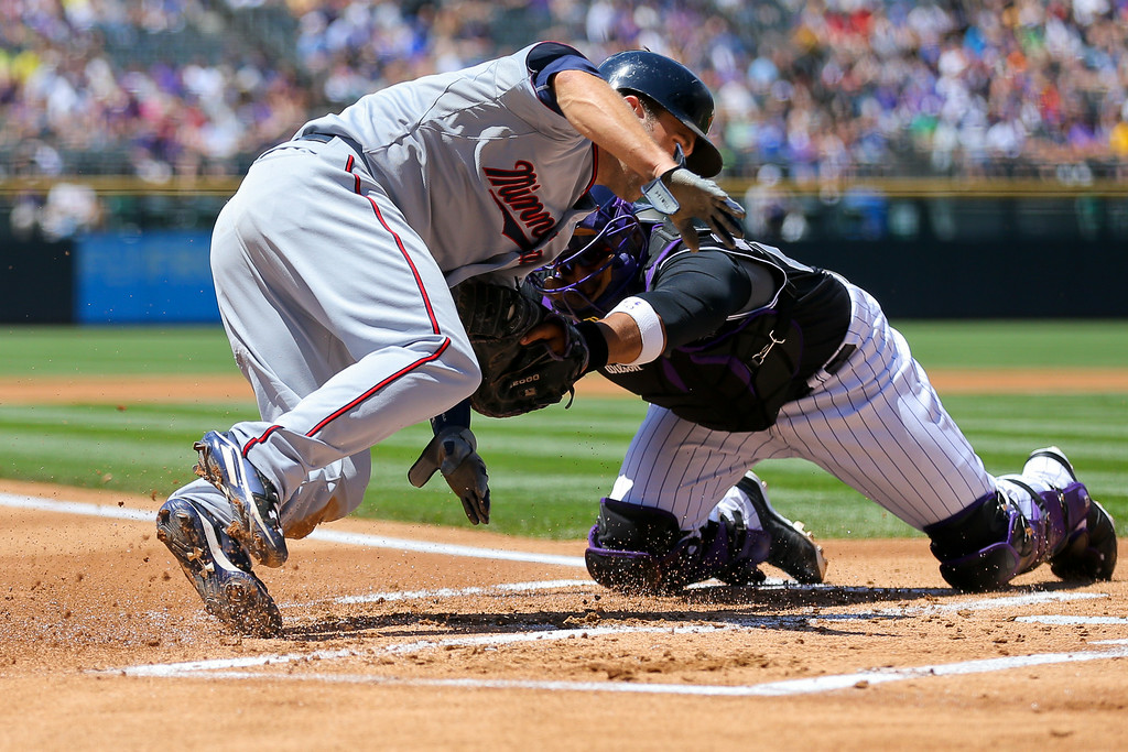 . Catcher Wilin Rosario #20 of the Colorado Rockies tags out Brian Dozier #2 of the Minnesota Twins for the second out of the first inning. (Photo by Justin Edmonds/Getty Images)
