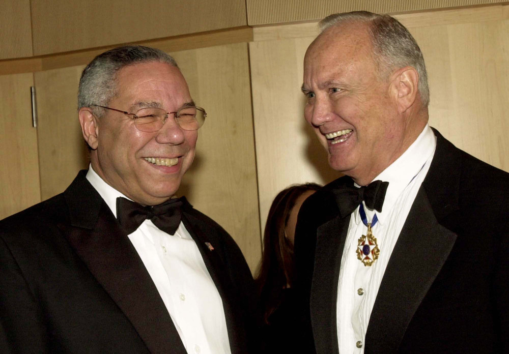 . U.S. Secretary of State Colin Powell and General H. Norman Schwartzkopf, U.S. Army (Ret.) talk at an award ceremony for former President George H.W. Bush December 6, 2002 in Washington, D.C. The National Defense University Foundation awarded the former president the American Patriot Award.  (Photo by Stefan Zaklin/Getty Images)