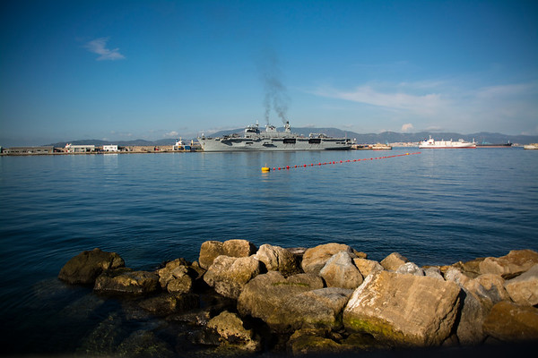 Royal Naval vessel HMS Ocean berthed at the British Naval Base in Gibraltar with Spain in the background.