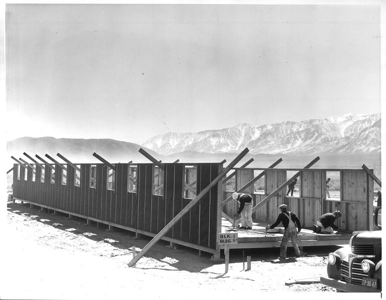 """""""Barracks To House Evacuated Japanese -- The first of 350 such barracks to house 10,000 Japanese evacuated from Southern California cities"""" -- caption on photograph"""