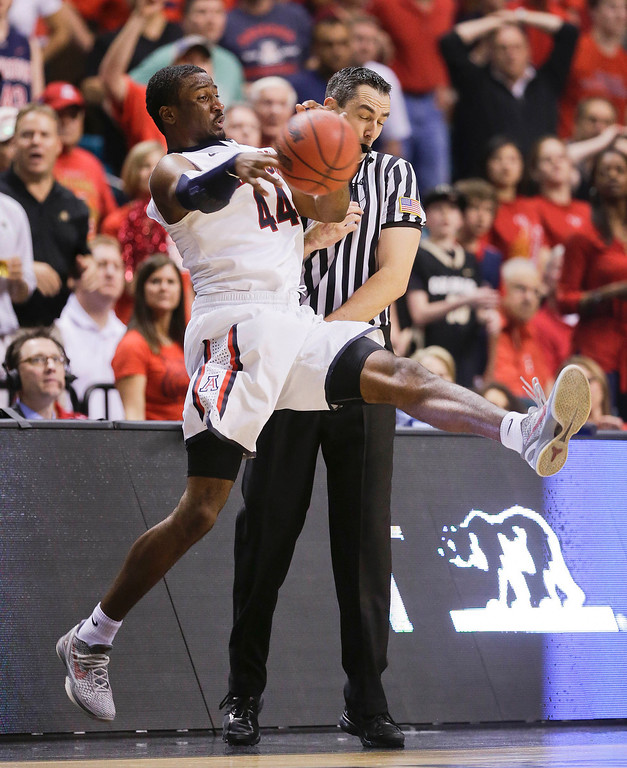 . Arizona\'s Solomon Hill saves the ball from going out of bounds in the second half against Arizona during a Pac-12 tournament NCAA college basketball game, Thursday, March 14, 2013, in Las Vegas. (AP Photo/Julie Jacobson)