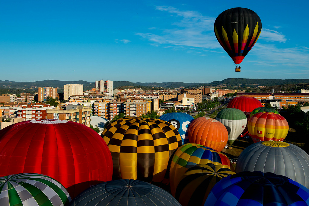 . A Hot air balloons flies over Igualada during an early flight as part of the European Balloon Festival on July 10, 2014 in Igualada, Spain. (Photo by David Ramos/Getty Images)