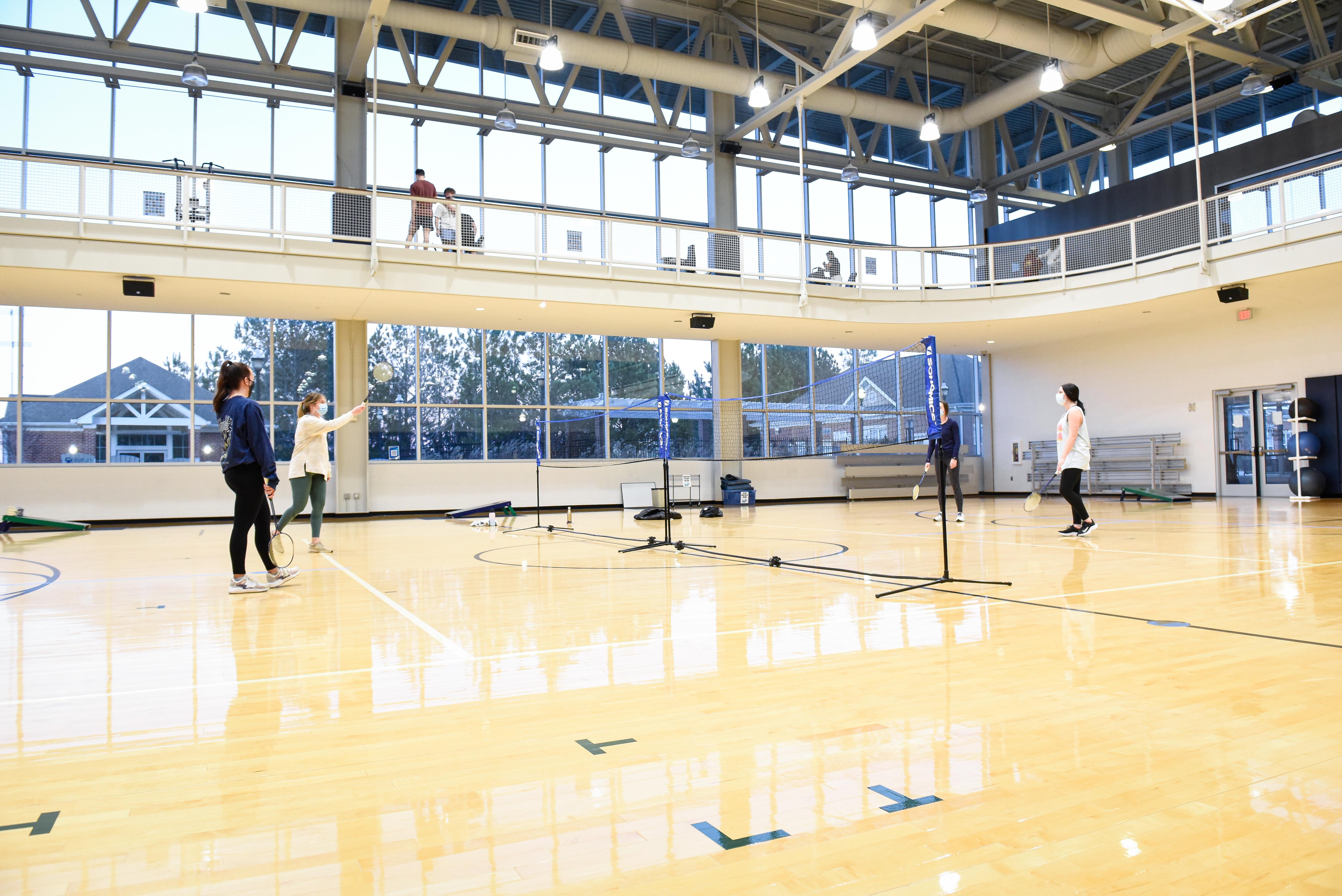 Students play badminton.