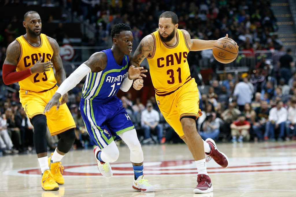 . Cleveland Cavaliers guard Deron Williams (31) is defended by Atlanta Hawks guard Dennis Schroder (17) in the second half of an NBA basketball game, Friday, March 3, 2017, in Atlanta. The Cavaliers won 135-130. (AP Photo/Brett Davis)