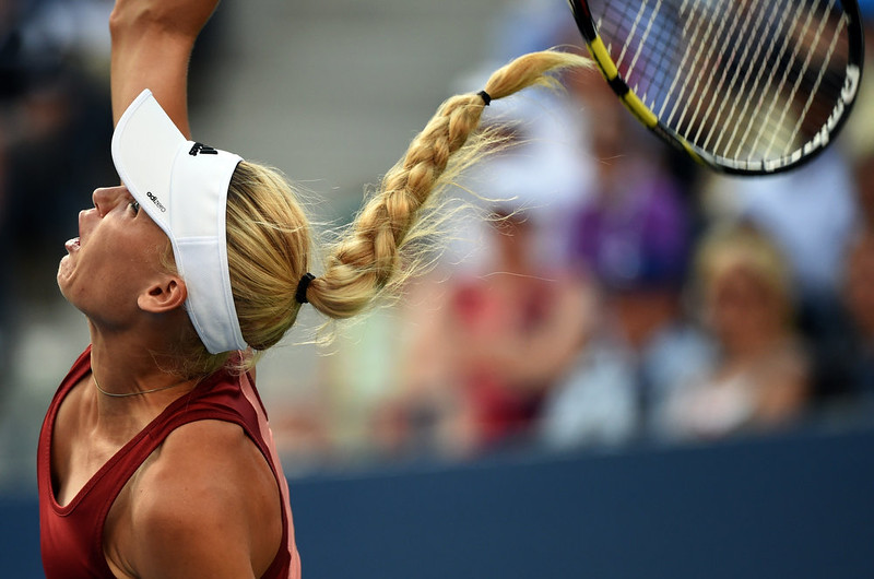 . Caroline Wozniacki of Denmark serves to Serena Williams of the US during their 2014 US Open Women\'s Singles - finals match at the USTA Billie Jean King National Tennis Center September 7, 2014 in New York.    TIMOTHY A. CLARY/AFP/Getty Images