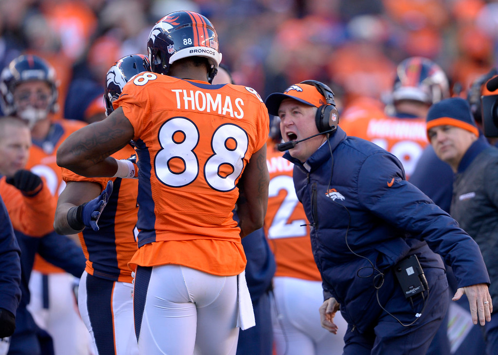 . Denver Broncos head coach John Fox greets Demaryius Thomas after his first quarter touchdown. The Denver Broncos vs. The San Diego Chargers in an AFC Divisional Playoff game at Sports Authority Field at Mile High in Denver on January 12, 2014. (Photo by Joe Amon/The Denver Post)