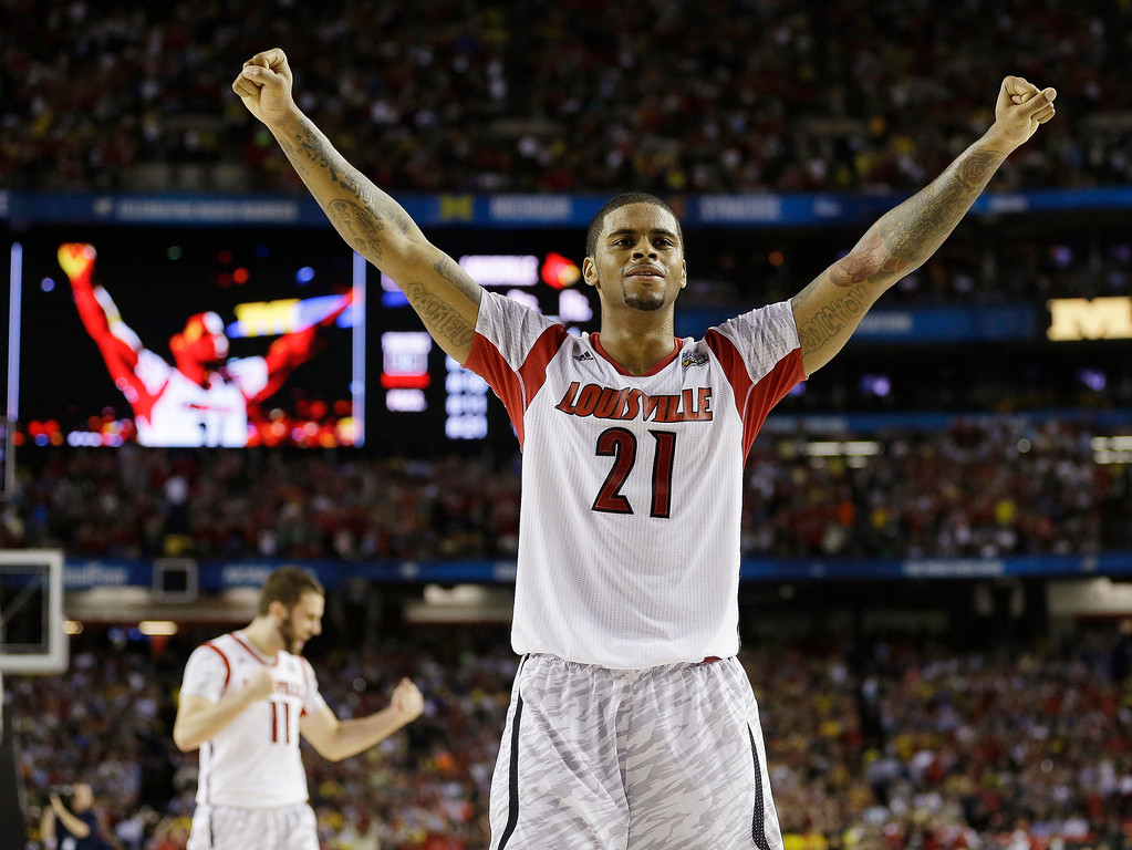 . Louisville forward Chane Behanan (21) reacts after defeating Michigan after the second half of the NCAA Final Four tournament college basketball championship game Monday, April 8, 2013, in Atlanta. Louisville won 82-76. (AP Photo/David J. Phillip)