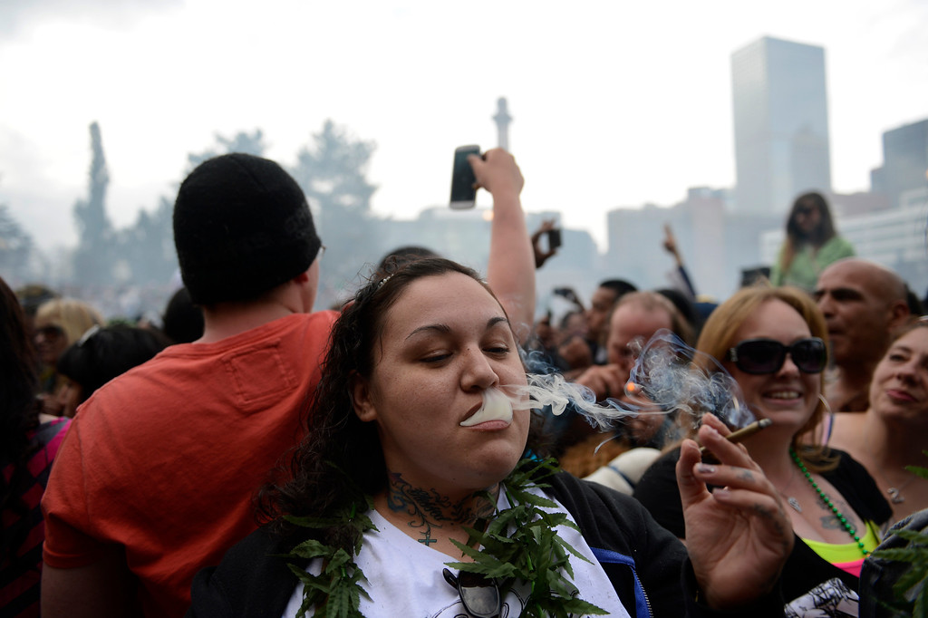. Juanita Powless of Wisconsin during the 4:20 pm smoke out during the annual 420 Rally at Civic Center Park in downtown Denver April 20, 2013 Denver, Colorado. (Photo By Joe Amon/The Denver Post)