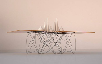 Jason Phillips developed 'Quantum Table', a sleek dining piece of furniture inspired by what the movement of subatomic particles might look like.