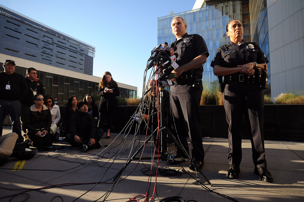 . Los Angeles police Lt. Andrew Neiman and officer Norma Eisenman conduct a morning briefing outside the LAPD headquarters downtown Los Angeles Wednesday, February 13, 2013.(Andy Holzman/Los Angeles Daily News)