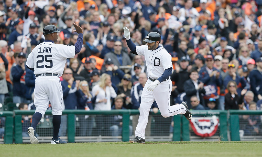 . Detroit Tigers\' Alex Avila rounds the bases after his two-run home run during the second inning of an opening day baseball game against the Minnesota Twins in Detroit, Monday, April 6, 2015. (AP Photo/Carlos Osorio)
